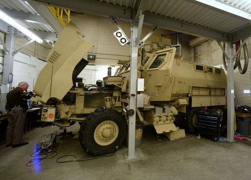 Rick Egan  | The Salt Lake Tribune   A mine-resistant vehicle (MRAP) is being fixed up for duty at the UHP maintenance shop in Taylorsville, Monday, January 13, 2014.