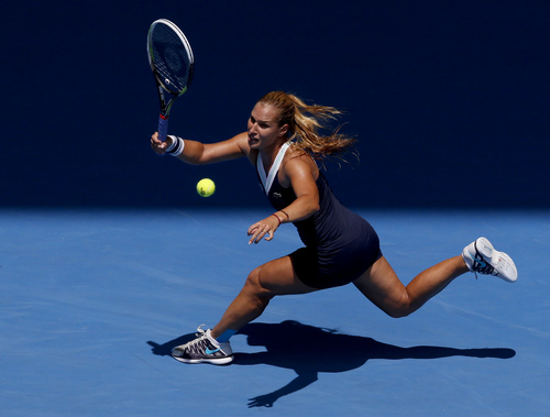 Eugene Hoshiko | The Associated Press Dominika Cibulkova hits a forehand return during her fourt-round victory over Maria Sharapova on Monday.