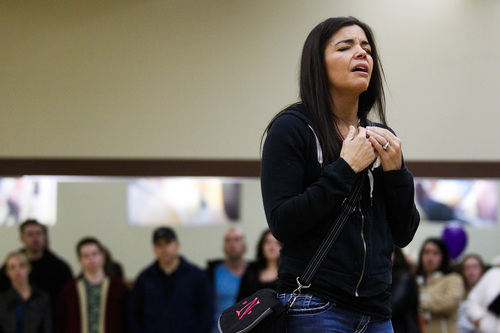 Nathalie Smith speaks during a memorial service and candlelight vigil for the Boren family at the Gold's Gym in Spanish Fork, Utah on Saturday, Jan. 18, 2014. Authorities believe Joshua Boren, a police officer, shot and killed his wife, mother-in-law and two young children before turning the gun on himself.   (AP Photo/Daily Herald, Spencer Heaps)