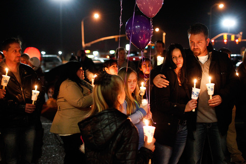 People gather during a memorial service and candlelight vigil for the Boren family at the Gold's Gym in Spanish Fork, Utah on Saturday, Jan. 18, 2014. Authorities believe Joshua Boren, a police officer, shot and killed his wife, mother-in-law and two young children before turning the gun on himself.   (AP Photo/Daily Herald, Spencer Heaps)