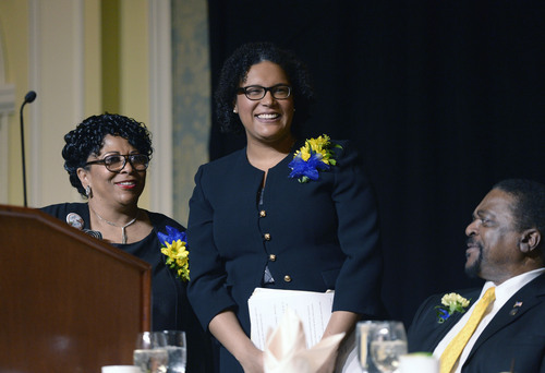Al Hartmann  |  The Salt Lake Tribune Monique Lin-Luse, special counsel for the education group of the NAACP Legal Defense and Educational Fund, center, speaks at the Martin Luther King Jr. Memorial Luncheon hosted by NAACP at the Grand America Hotel Monday.  Jeanetta Williams, president of the NAACP Salt Lake Branch, left. Edward L. Lewis, chairman, luncheon, right.