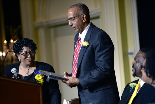Al Hartmann  |  The Salt Lake Tribune Jeanetta Williams, president of the NAACP Salt Lake Branch, left, presents the Dr. Martin Luther King Jr. Award to Dr. Michael J, McFarland, associate professor of Civil and Environmental Engineering at Utah State University, at the Martin Luther King Jr. Award Luncheon at the Grand America Monday.