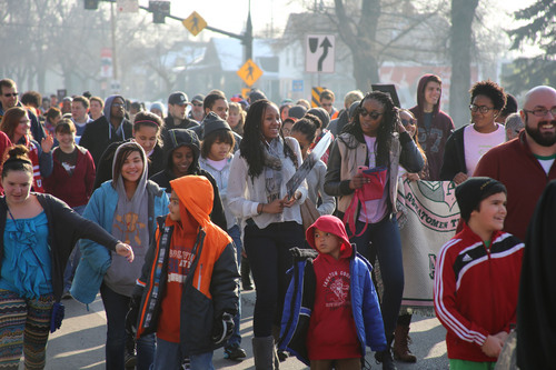 Francisco Kjolseth  |  The Salt Lake Tribune University of Utah students and members of the community march 1.3 miles from East High School to Kingsbury Hall in honor of MLK day. Donations accepted at the end of the March for Youth go toward the Rev. France Davis Scholarship Fund.