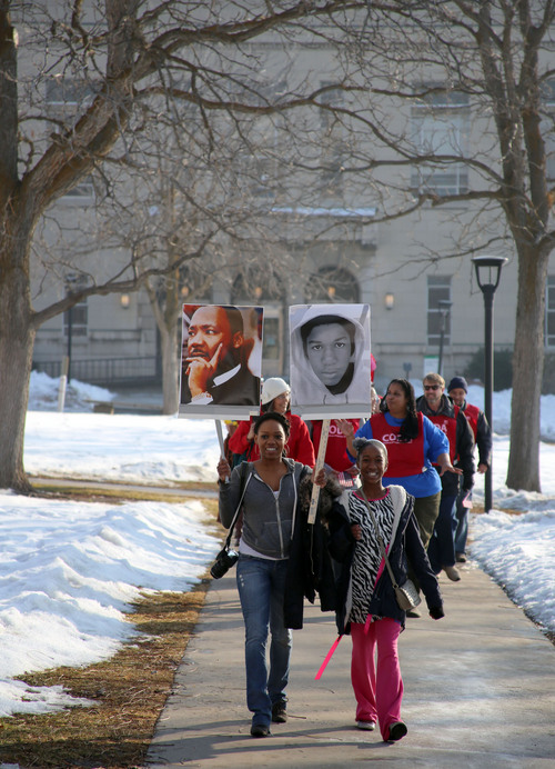 Francisco Kjolseth  |  The Salt Lake Tribune Sheena Hathorne alongside her daughter Makyla, 10, join University of Utah students and members of the community on the march from East High School to Kingsbury Hall in honor of Martin Luther King Jr. Day. Donations accepted at the end of the March for Youth went  to the Rev. France Davis Scholarship Fund for African-American students..