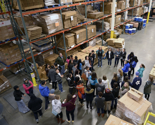 Al Hartmann  |  The Salt Lake Tribune Student volunteers from Youth City, Americorps, and Juan Diego High School gather at the Utah Food Bank to clean and organize food barrels to celebrate Martin Luther King Day.  The students were joined by private individuals and corporate groups to prepare food boxes and deliver them to elderly and others with food needs.