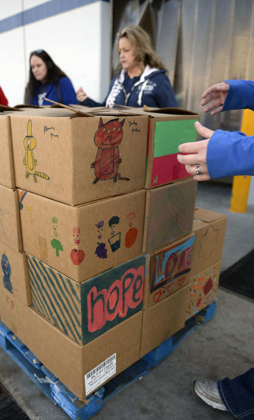 Al Hartmann  |  The Salt Lake Tribune Decorated food boxes for the elderly wait at the loading dock to be delivered to elderly and others with food needs.  Volunteers from youth groups, private individuals and corporate groups gathered at the Utah Food Bank for Martin Luther King Day to clean food barrels and prepare food boxes.