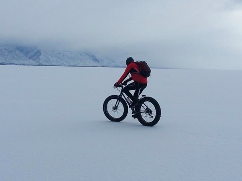 | Courtesy Burton family  Daniel Burton of Saratoga Springs biking across Utah Lake in January 2013. The morning of Jan. 21, 2014, Burton finished the first-ever biking expedition from the Antarctic coast to the South Pole.