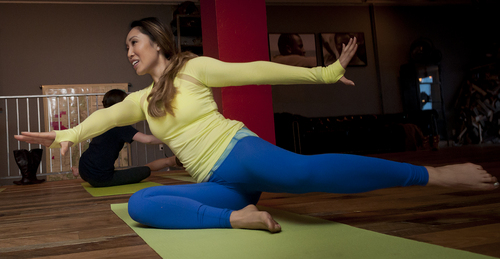 Michael Mangum  |  Special to the Salt Lake Tribune  Fitness instructor Cassey Ho leads a session of yogalates, a fusion of yoga and pilates, during a free event at the Youtube Lounge at the Sundance Film Festival in Park City on Saturday, January 18, 2014.