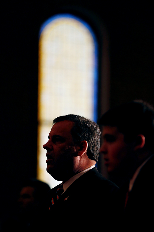 New Jersey Gov. Chris Christie is silhouetted as he attends a prayer service with his family in celebration of his inauguration at the New Hope Baptist Church on Tuesday, Jan. 21, 2014 in Newark. The celebrations to mark the start of Christie's second term could be tempered by investigations into traffic tie-ups that appear to have been ordered by his staff for political retribution and an allegation that his administration linked Superstorm Sandy aid to approval for a real estate project. (AP Photo/Rich Schultz)