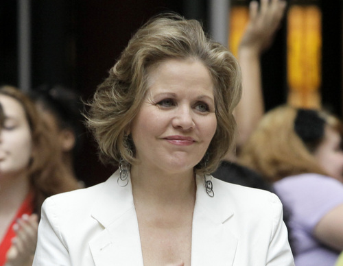FILE - This March 19, 2012 file photo shows opera singer Renee Fleming in the rotunda of the State of Illinois building, the James R. Thompson Center, in Chicago. Fleming, a four-time Grammy winner, will perform sing the national anthem before the Denver Broncos take on the Seattle Seahawks at MetLife Stadium in East Rutherford, N.J. on Feb 2. (AP Photo/Kiichiro Sato)