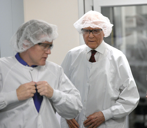 Al Hartmann  |  The Salt Lake Tribune Sen. Orrin Hatch (R-Utah), right, suits up in a hairnet and white coat to visit BD's automated manufacturing facility in Sandy, Utah, on Wednesday, Jan. 22, 2014, with plant manager Corey Thayn. BD is a global medical technology company that makes medical supplies, devices and dignostic products. He toured the plant and discussed the implications of the Medical Device Tax as part of funding for Obamacare and other challenges to the competitiveness of the industry.