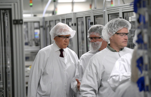 Al Hartmann  |  The Salt Lake Tribune Sen. Orrin Hatch (R-Utah), left, dressed in a hairnet and white coat, visits BD's automated manufacturing facility in Sandy, Utah, on Wednesday, Jan. 22, 2014, with company management. BD is a global medical technology company that makes medical supplies, devices and dignostic products. Hatch toured the plant and discussed the implications of the Medical Device Tax as part of funding for Obamacare and other challenges to the competitiveness of the industry.