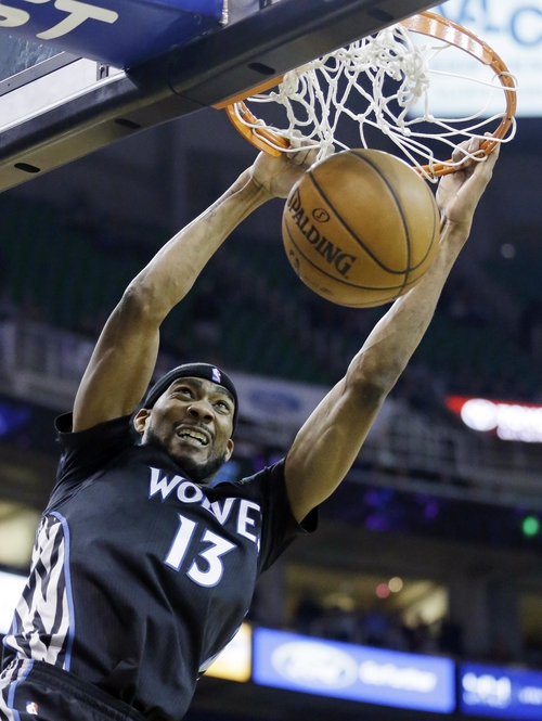 Minnesota Timberwolves' Corey Brewer (13) dunks the ball against the Utah Jazz in the second half during an NBA basketball game, Tuesday, Jan. 21, 2014, in Salt Lake City. The Timberwolves won 112-97. (AP Photo/Rick Bowmer)
