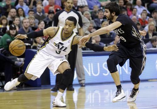 Minnesota Timberwolves' Ricky Rubio (9), of Spain, defends against Utah Jazz's Trey Burke (3) in the first quarter during an NBA basketball game, Tuesday, Jan. 21, 2014, in Salt Lake City. (AP Photo/Rick Bowmer)