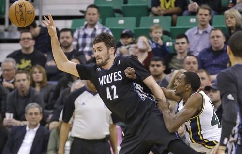 Utah Jazz's Jeremy Evans, right, fouls Minnesota Timberwolves' Kevin Love (42) in the first quarter during an NBA basketball game, Tuesday, Jan. 21, 2014, in Salt Lake City. (AP Photo/Rick Bowmer)