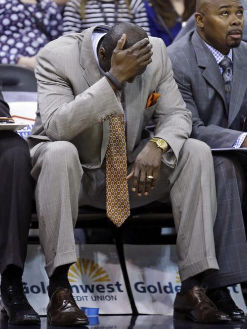 Utah Jazz head coach Tyrone Corbin lowers his head in the fourth quarter during an NBA basketball game against the Minnesota Timberwolves, Tuesday, Jan. 21, 2014, in Salt Lake City. The Timberwolves won 112-97. (AP Photo/Rick Bowmer)