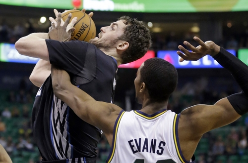 Minnesota Timberwolves' Kevin Love, left, is fouled by Utah Jazz's Jeremy Evans, right, in the second half during an NBA basketball game, Tuesday, Jan. 21, 2014, in Salt Lake City. The Timberwolves won 112-97. (AP Photo/Rick Bowmer)