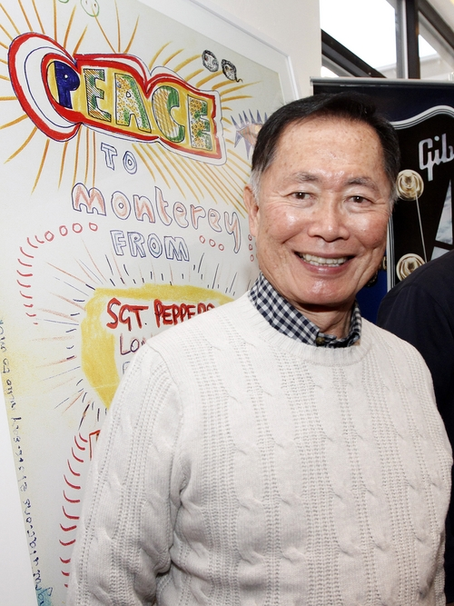 Actor George Takei posed before an original Beatles art piece at Quaker Good Energy Lodge with GenArt and the Collective during Sundance 2014 on Saturday, Jan. 18, 2014 in Park City. (Photo by Dan Harr/Invision for Collective Cabin/AP Images)
