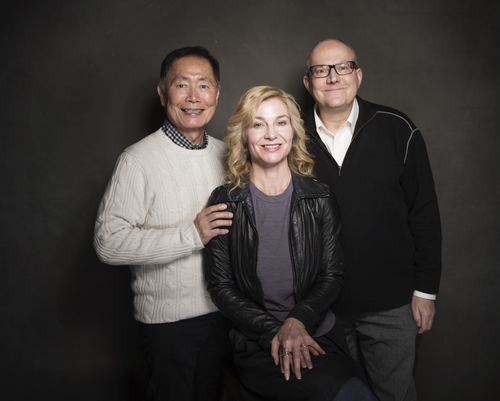 From left, George Takei, Jennifer M. Kroot and Brad Takei pose for a portrait at The Collective and Gibson Lounge Powered by CEG, during the Sundance Film Festival, on Saturday, Jan. 18, 2014 in Park City, Utah. (Photo by Victoria Will/Invision/AP)