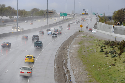 Sarah A. Miller  | Tribune file photo Early morning traffic heads south into Salt Lake City through hail and rain just past the 600 North exit off of I-15 on Tuesday, April 26, 2011. In 2012, Utah is on pace to have the fewest number of traffic fatalities since 1959.