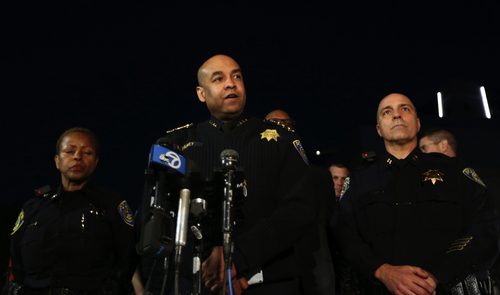 Bay Area Rapid Transit police Chief Kenton Rainey, center, speaks to the media outside Eden Medical Center in Castro Valley, Calif., Tuesday, Jan. 21, 2014. Rainey announced the tragic loss of the first BART officer killed in the line of duty. The officer was fatally shot while serving a probation search warrant at a residence in Dublin, Calif. (AP Photo/The Contra Costa Times, Anda Chu)