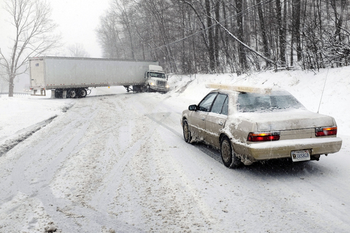 A jackknifed tractor-trailer blocks the eastbound lanes of Route 7 near the Clarke-Frederick County, Va. State line during a snow storm Tuesday, Jan. 21, 2014. (AP Photo/The Winchester Star, Scott Mason)