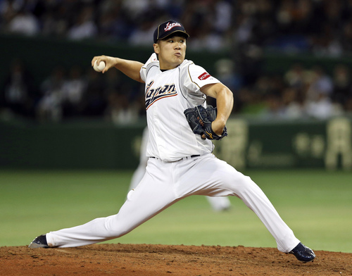 FILE - In this March 12, 2013, file photo, Japan's Masahiro Tanaka pitches against the Netherlands in the fifth inning of a World Baseball Classic second round game at Tokyo Dome in Tokyo. The New York Yankees and Tanaka agreed on Wednesday, Jan. 22, 2014, to a $155 million, seven-year contract. In addition to the deal with the pitcher, the Yankees must pay a $20 million fee to the Japanese team of the 25-year-old right-hander, the Rakuten Golden Eagles. (AP Photo/Toru Takahashi, File)