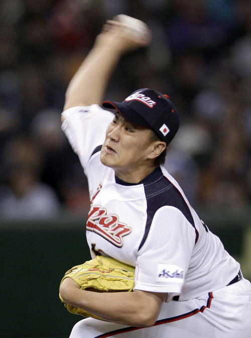 FILE - In this March 10, 2012, file photo, Japan's starter Masahiro Tanaka delivers a pitch against Taiwan in the first inning of their charity baseball game at Tokyo Dome in Tokyo, on the eve of the anniversary of the March 11 earthquake and tsunami. The New York Yankees and Tanaka agreed on Wednesday, Jan. 22, 2014, to a $155 million, seven-year contract. In addition to the deal with the pitcher, the Yankees must pay a $20 million fee to the Japanese team of the 25-year-old right-hander, the Rakuten Golden Eagles. (AP Photo/Toru Takahashi, File)
