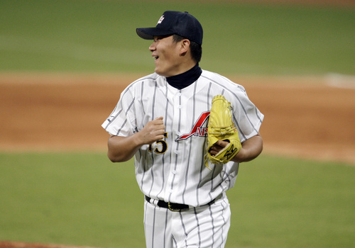 FILE - In this Aug. 20, 2008, file photo, Japan's pitcher Masahiro Tanaka reactas after watching second baseman Masahiro i Araki knock down what could have been a base hit by the USA's Taylor Teagarden for the third out in the sixth inning in their baseball game at the Beijing 2008 Olympics in Beijing. The New York Yankees and Tanaka agreed on Wednesday, Jan. 22, 2014, to a $155 million, seven-year contract. In addition to the deal with the pitcher, the Yankees must pay a $20 million fee to the Japanese team of the 25-year-old right-hander, the Rakuten Golden Eagles. (AP Photo/Kathy Willens, File)