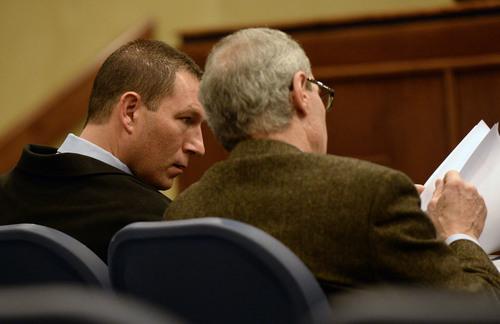 Al Hartmann     The Salt Lake Tribune West Valley City Police Lt. John Coyle, left, talks with his attorney Erik Strindberg at the West Valley City Civil Service Commission on Thursday, Jan. 16.