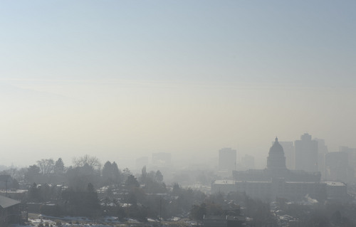 Francisco Kjolseth  |  The Salt Lake Tribune The pollution-plagued Salt Lake Valley is obscured by another red air day as they inversion continues on Wednesday, Jan. 22, 2014. A weak storm predicted for Thursday could bring a little relief but is not expected to last.