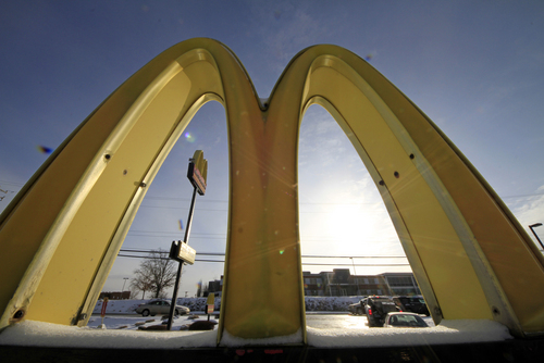 In this Tuesday, Jan. 21, 2014, photo, cars drive past the McDonald's Golden Arches logo at a McDonald's restaurant in Robinson Township, Pa. McDonald's reports quarterly earnings on Thursday, Jan. 23, 2014.  (AP Photo/Gene J. Puskar)