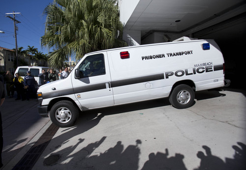 A Miami Beach, Fla., police prisoner transport van leaves the Miami Beach Police building believed to be transporting pop singer Justin Bieber and R&B singer known as Khalil after their arrest, Thursday, Jan. 23, 2014 in Miami Beach.   Bieber and Khalil both face drag-racing and driving under the influence charges. (AP Photo/Wilfredo Lee)