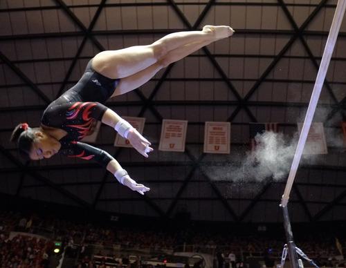 Trent Nelson  |  The Salt Lake Tribune Utah's Kassandra Lopez on the bars as Utah hosted BYU gymnastics Friday, January 27, 2012 in Salt Lake City, Utah.