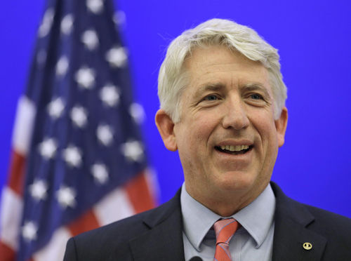 FILE - Virginia Attorney General-elect Mark Herring smiles during a news conference at the Capitol in Richmond, Va., in this Dec. 18, 2013 file photo. Herring has concluded that the state's ban on gay marriage is unconstitutional and he will no longer defend it in federal lawsuits challenging it, his office said Thursday Jan. 23, 2014. (AP Photo/Steve Helber, File)