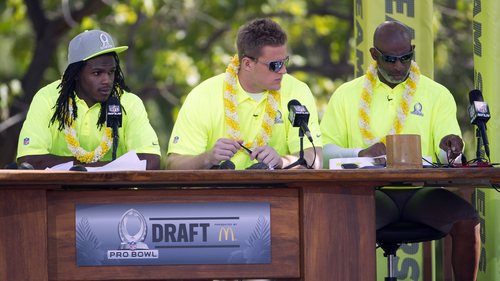 Kansas City Chiefs running back Jamaal Charles, left, Houston Texans defensive end J.J. Watt, center, and Hall of Famer and alumni team captain Deion Sanders, right, check their notes during day two of the 2014 Pro Bowl Draft, Wednesday, Jan. 22, 2014, in Kapolei, Hawaii. (AP Photo/Eugene Tanner)