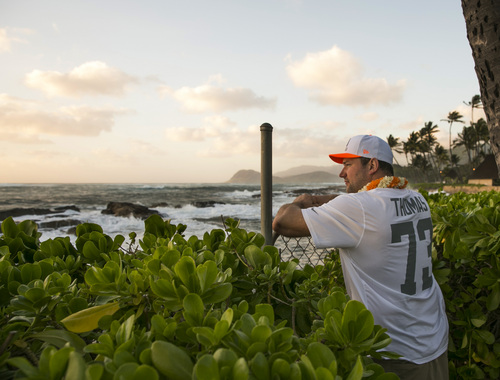 Cleveland Browns offensive tackle Joe Thomas looks out toward the ocean during the NFL football Pro Bowl draft, Wednesday, Jan. 22, 2014, Kapolei, Hawaii. (AP Photo/Marco Garcia)