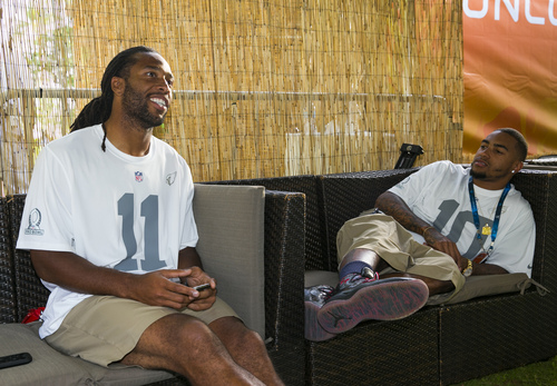 Arizona Cardinals wide receiver Larry Fitzgerald, left, and Philadelphia Eagles wide receiver DeShawn Jackson chat in the green room during the NFL football Pro Bowl draft, Wednesday, Jan. 22, 2014, in Kapolei, Hawaii. (AP Photo/Marco Garcia)