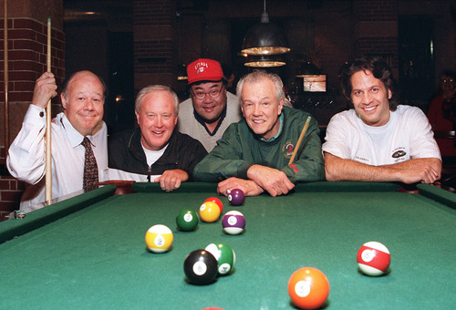 Craig Wirth, Ron Mc Bride, Randy Horiuchi, Hot Rod Hundley and Kurt Bestor get ready to rackem' up at the party for the Travelers Aid Shelter.     Michael J. Miller photo