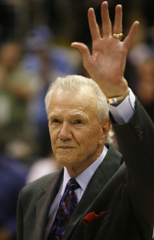 Salt Lake City - Utah Jazz announcer Hot Rod Hundley waves to the cheering crowd as he receives recognition for announcing his 3,000th Jazz games during halof time of the Utah Jazz New Orleans Hornets game at the EnergySolutions Arena  Wednesday  January 7, 2009.  . Steve  Griffin/The Salt Lake Tribune 1/7/09