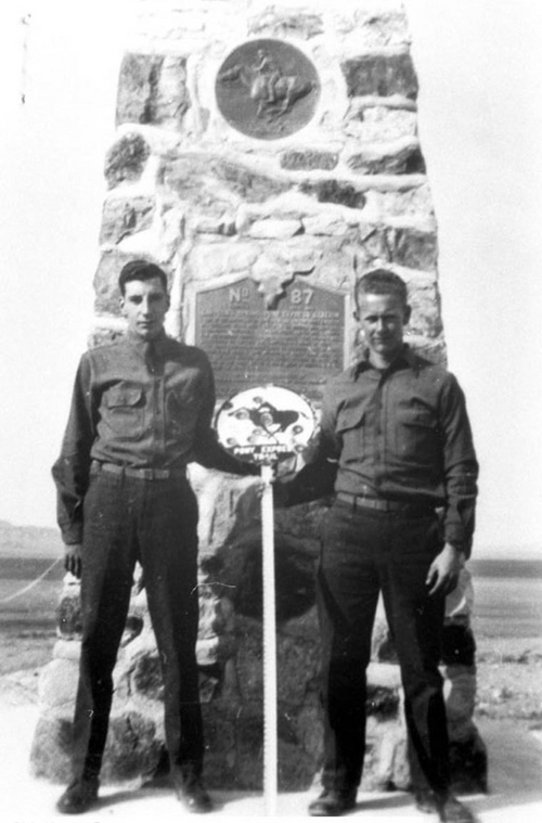 Photo Courtesy Utah State Historical Society  Image shows two CCC enrollees posing for a photograph in front of Pony Express Marker No. 87, west of Vernon, Tooele County, Utah. This marker was built in 1940 by members of CCC Company 2517 from Camp DG-154, Simpson Springs.