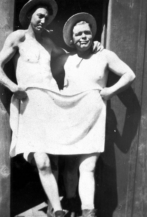 Photo Courtesy Utah State Historical Society  Image shows two members of the F-9 Mount Nebo (Nephi) Camp covering themselves with only a bath towel, between 1933-42.