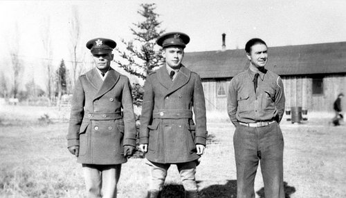 Photo Courtesy Utah State Historical Society  Image shows two CCC officers and an enrollee posing for a photograph at the Ferron CCC Camp.