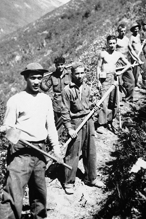 Photo Courtesy Utah State Historical Society  Image shows members of the Hobble Creek (Utah County) CCC crew clearing a trail between 1933-39.