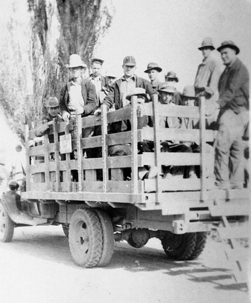 Photo Courtesy Utah State Historical Society  Image shows a CCC crew in the back of a truck between 1933-42.