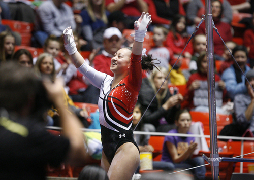 Scott Sommerdorf   |  The Salt Lake Tribune Utah gymnast Corrie Lothrop after her uneven parallel bars routine  during the Utah Red Rocks preview at the Huntsman Center, Friday December 13 2013.