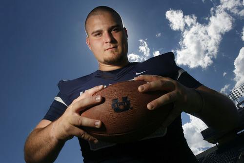 Scott Sommerdorf   |  The Salt Lake Tribune USU C Tyler Larsen at Romney Stadium in Logan, Thursday, August 1, 2013.