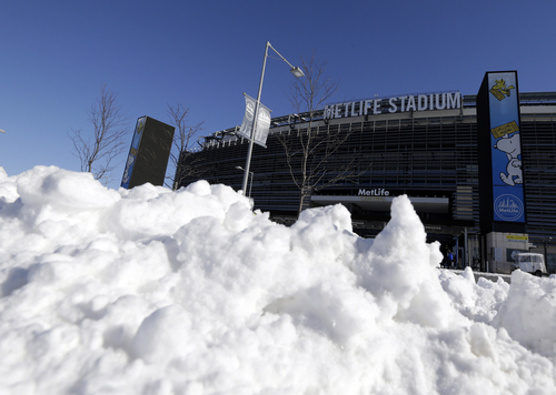 Snow is accumulated near an entrance to MetLife Stadium following a snow storm, Wednesday, Jan. 22, 2014, in East Rutherford, N.J. The NFL football title game, held Feb. 2, will be the first Super Bowl held outdoors in a city where it snows. Super Bowl XLVIII, which will be played between the Denver Broncos and the Seattle Seahawks on Feb. 2, will be the first NFL title game held outdoors in a city where it snows. (AP Photo/Julio Cortez)