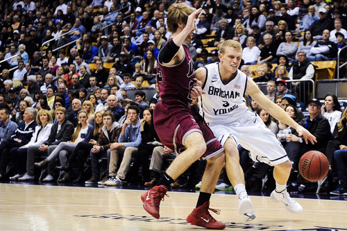 BYU guard Tyler Haws, tight, attempts to drive past Loyola Marymount's Chase Flint during an NCAA college basketball game on Saturday, Jan. 11, 2014, in Provo, Utah. (AP Photo/Daily Herald, Alex Goodlett)