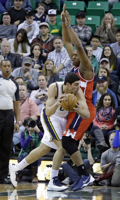Utah Jazz's Enes Kanter (0), of Turkey, drives as Washington Wizards' Kevin Seraphin (13) defends during the second quarter of an NBA basketball game Saturday, Jan. 25, 2014, in Salt Lake City. (AP Photo/Rick Bowmer)
